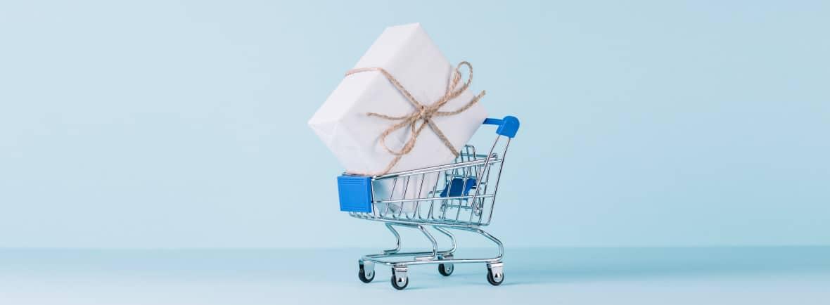 Arbitragem e direito do consumidor: Carrinho de supermercado com um presente dentro